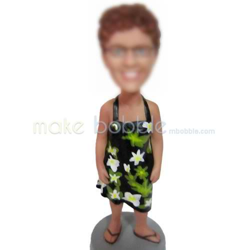 bobble head dolls of flower dress