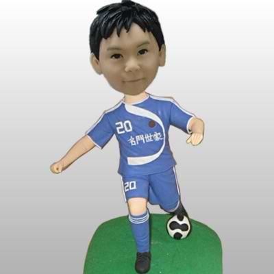 Little boy playing soccer bobblehead
