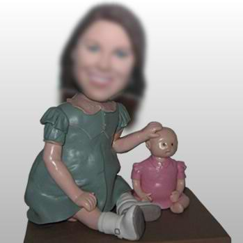 The little girl with toys bobblehead