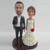 Custom bobbleheads of wedding cake