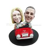 Personalized couple in red car bobble heads