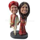Wedding bobbleheads couple in traditional clothes