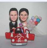 Personalized custom sweet bride and groom with their red sports car bobblehead
