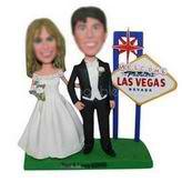 Groom in black suit and groom in wedding dress in les vegas custom bobbleheads