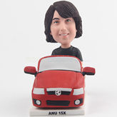 Handsome young man in a red car bobblehead
