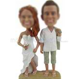 Custom bobbleheads of Beach wedding