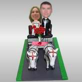 Ride the skin couple of carriage bobbleheads