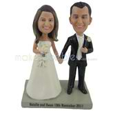 The bride and groom hold hands custom bobbleheads