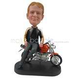 Custom man bobbleheads sit on his motobike