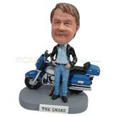 The man stands behind the motobike custom bobbleheads