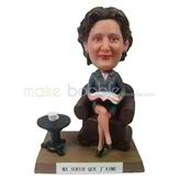 The woman boss sits on the couch custom bobbleheads