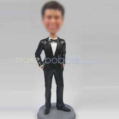 man in black suit bobble head doll