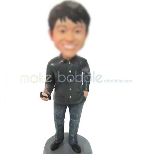 man with telephone bobbleheads